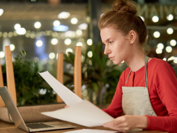 Small business owner researches business loans for bad credit