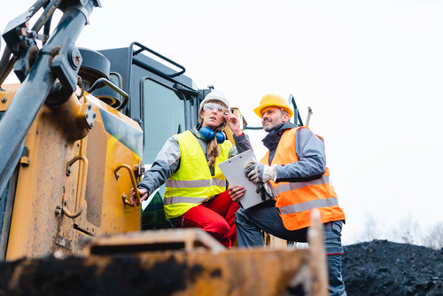 Construction workers use new equipment, bought using the Section 179 deduction.